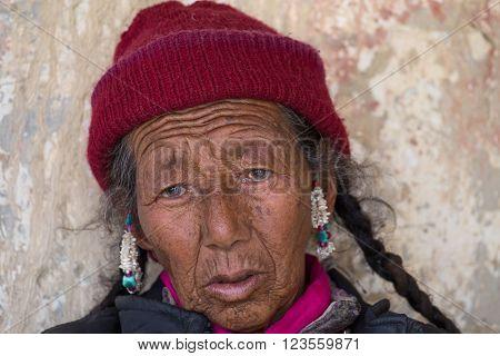 LAMAYURU, INDIA - JUNE 15, 2015: Unidentified buddhist old women during mystical mask dancing Tsam mystery dance in time of Yuru Kabgyat Buddhist festival at Lamayuru Gompa, Ladakh, North India