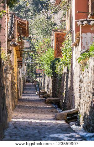 Ollantaytambo, Urubamba/peru - Circa June 2015: Old Narrow Street And Brick Buildings In Ollantaytam