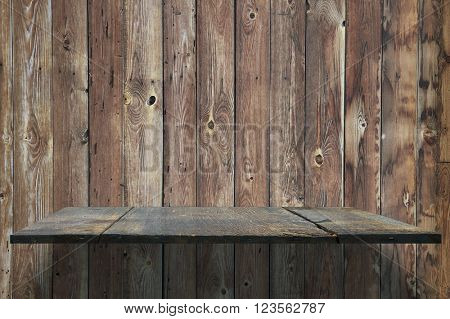empty shelves on wooden wall