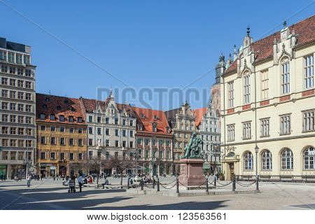Wroclaw, Poland - Circa March 2012: Aleksander Fredr Monument And Central Market Square In  Wroclaw