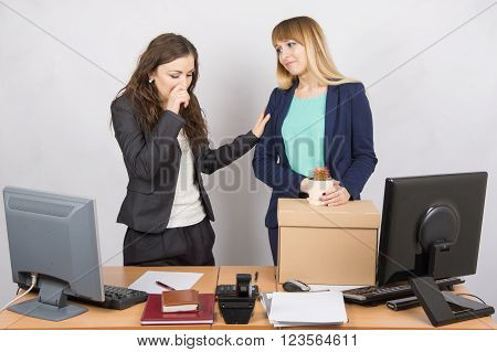 Office Worker With Tears Accompanies The Dismissed Colleague