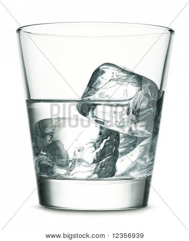 Glass of vodka with ice on white background