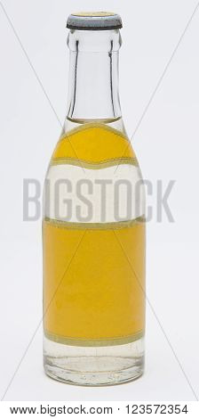 old school clear soft drink bottle against white background