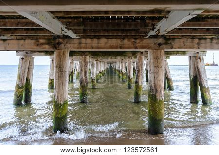 Underneath the Sopot pier in Poland the longest wooden pier in Europe