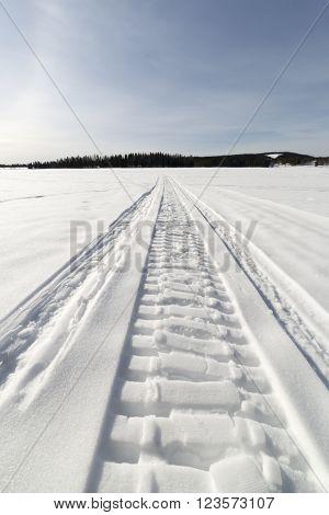 Snow Mobile Tracks on Lake in Sweden.