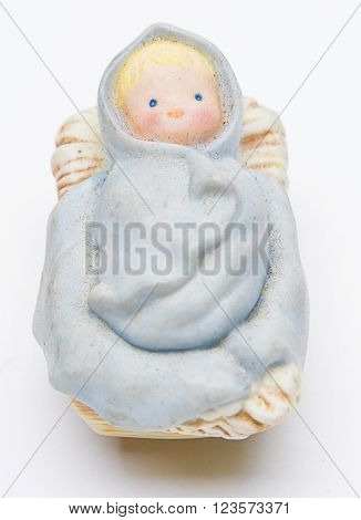 vintage figure of a baby jesus of the christmas nativity scene