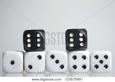 Dice. Throwing the dice during the game. Cubes of white and black color on on the same on.