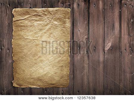 Vintage paper on wooden panel