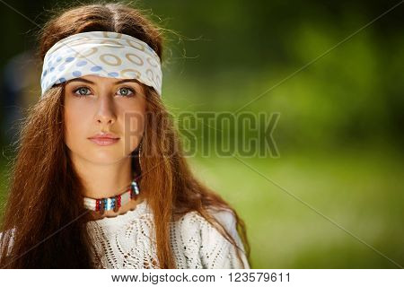 Beautiful hippie girl with long hair. Boho fashion style