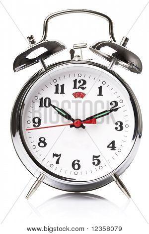 Old fashioned alarm clock on white background