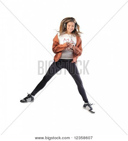 Smiling young woman jumping and dancing to music