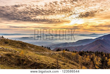 Sunset In The Mountains. View Of The Valley
