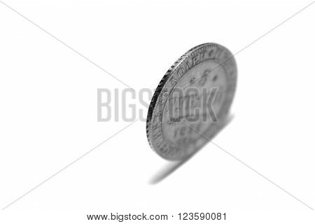 One coin, isolated on white background, black and white photo ** Note: Shallow depth of field