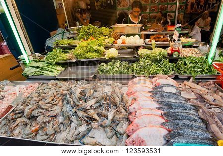 BANGKOK, THAILAND - FEB 14: Seafood market stall with shrimps brines fish on popular food market street on February 14, 2016. Population of Bangkok is over 8 million most populous city of Thailand.