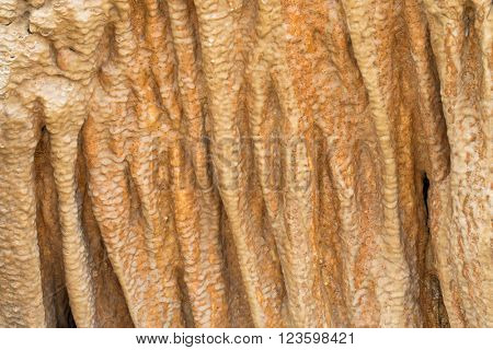 Closeup background texture cave stone curtain photo of stalactite cavern