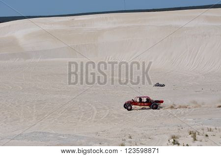 LANCELIN,WA,AUSTRALIA-SEPTEMBER 28,2015: Recreational red dune buggy on the white sand dunes in Lancelin, Western Australia.