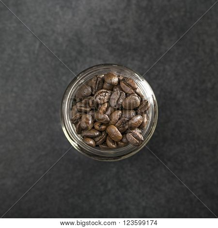 Coffee beans in a glass jar from above