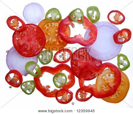 Brighten tomato, pepper, onion slices  on a white