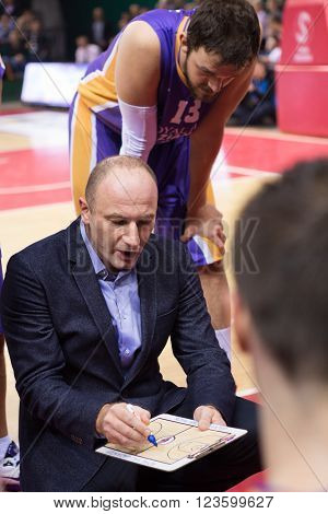SAMARA RUSSIA - NOVEMBER 06, 2013: BC Royal Hali Gaziantep head coach Aziz Bekir during a timeout of the BC Krasnye Krylia basketball game on November 06 2013 in Samara Russia.