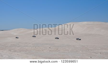 LANCELIN,WA,AUSTRALIA-SEPTEMBER 28,2015: Four recreational vehicles off road at the white sand dunes tourist attraction in Lancelin, Western Australia.