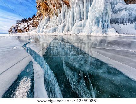 Winter frozen ice. Lake Baikal. Global warming