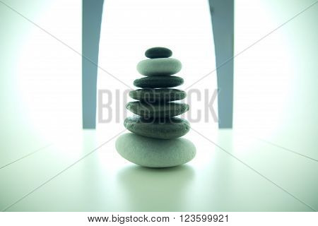 Balanced stone pile on a white surface
