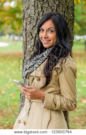 woman listening to music on mobile phone