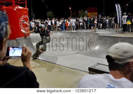 FREMANTLE,WA,AUSTRALIA-SEPTEMBER 30,2015: Skateboarding showcase at night with spectators at the Esplanade Youth Plaza in Fremantle, Western Australia.