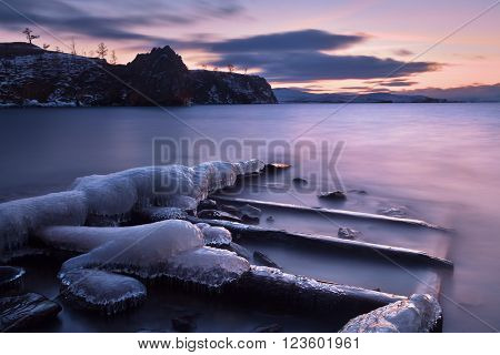Winter Baikal lake landscape with Sun on blue sky