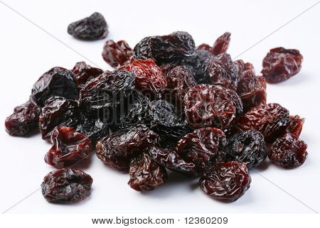 Black raisins on a white background