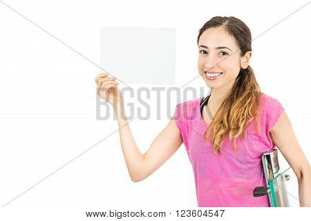 Diet woman with a scale under her arm showing text space. Isolated on white background.