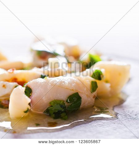 Appetizer of squid in a spicy marinade. Selective focus. ** Note: Shallow depth of field