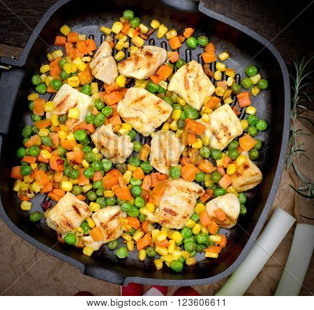 Chicken breast - white chicken meat with vegetables in pan