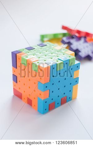 Colorful plastic jigsaw puzzle game stock photo