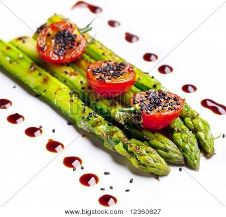 Fried green asparagus on a white background