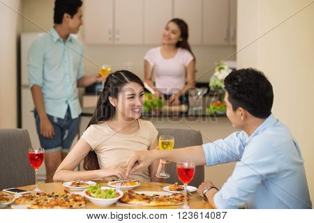 Couple drinking liqueur and talking at dinner party ** Note: Soft Focus at 100%, best at smaller sizes