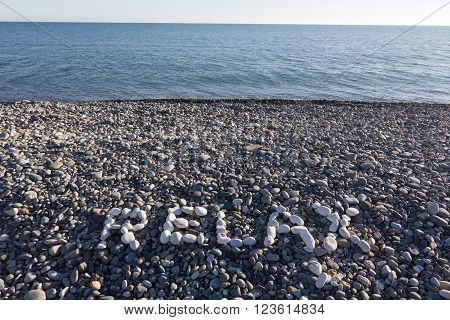 The Sign Relax Made From White Pebbles On Pebble Beach On The Sea