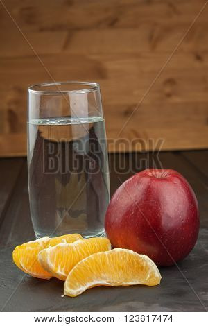 Glasses of water and fruit. Food for weight reduction. Diet program. Controlled diet. Healthy diet for athletes. Diet food. Fruity breakfast.
