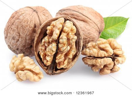 Walnuts with leaf isolated on a white background.