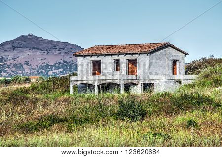unfinished house in the countryside on a clear day