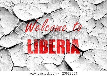 Grunge cracked Welcome to liberia card with some soft highlights