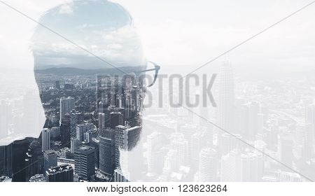 Photo of stylish bearded lawyer wearing trendy suit and looking city. Double exposure, panoramic view contemporary City background.