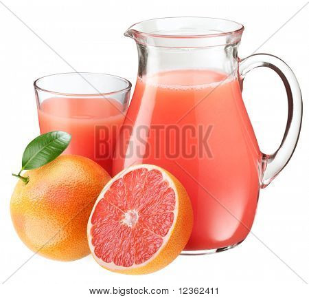 Full glass and jar of grapefruit juice and fruits in front.