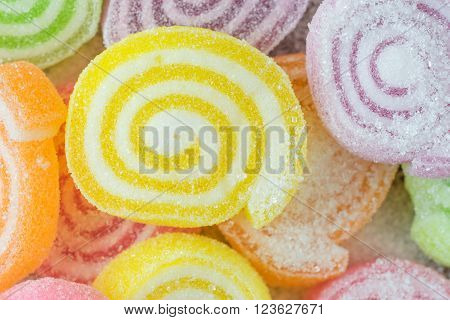 Jelly sweet flavor fruit candy dessert colorful on sugar.
