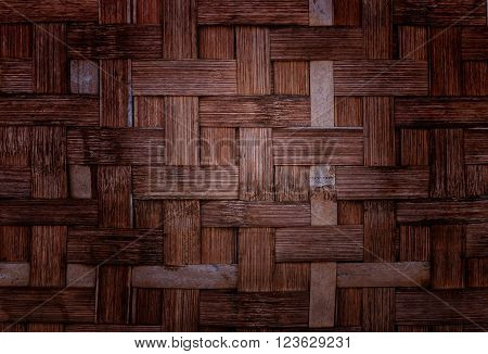Closeup brown bamboo weave texture background, Woven wood pattern of Thailand,