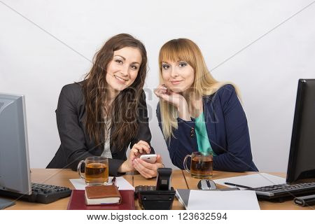 Two Office Girls Chatting And Drinking Tea At Your Desk