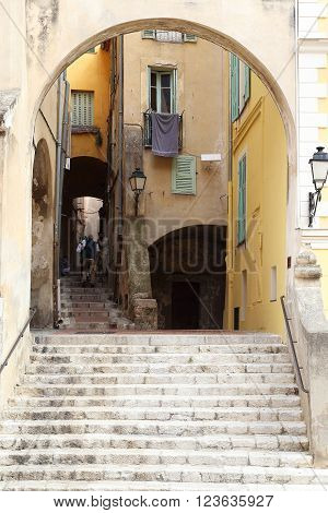 Menton, France - May 21: This is street with archway to old town from square near Basilica of St. Michael May 21, 2015 Menton, France.