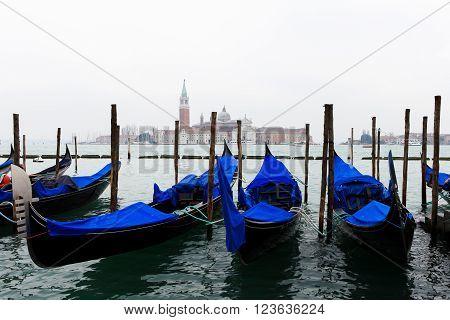 Gondolas in Saint Mark's square (San Marco) with The Church of San Giorgio Maggiore in the background