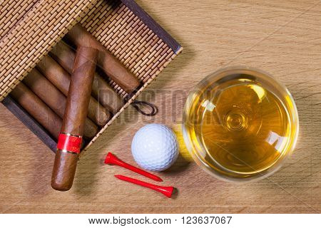 Luxury Cuban cigars on the wooden table