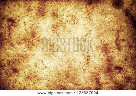 old grungy paper with stains as background
